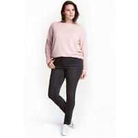 H&M H&M+ Elastyczne spodnie 0352811014 Prawie czarny