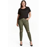 H&M H&M+ Elastyczne spodnie 0352811023 Zieleń khaki/Do kostki