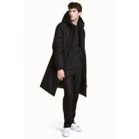 H&M Watowany płaszcz z kapturem 0417832001 Czarny