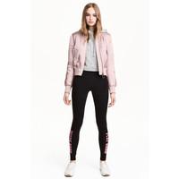 H&M Dżersejowe legginsy 0426541001 Czarny/Różowy