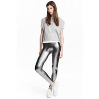 H&M Powlekane legginsy 0531074001 Srebrny